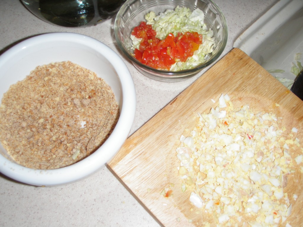 """The makings"" for chick food -- chopped veggies, dry bread crumbs, hard-boiled egg."
