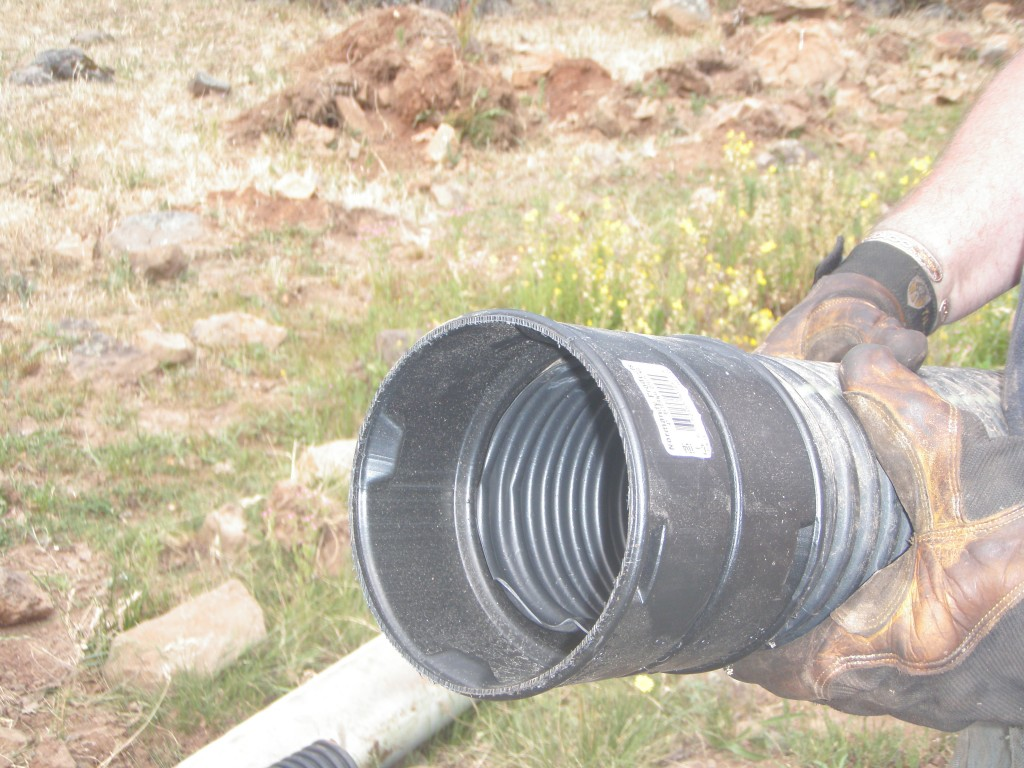 Coupler attached to one end of the pipe.