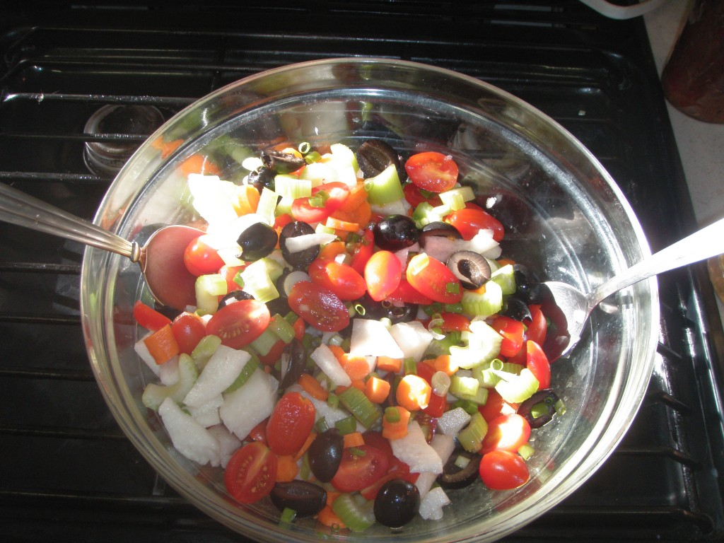 This goes on top of the greens -- jicama, olives, tomatoes, carrots, green onions, celery.
